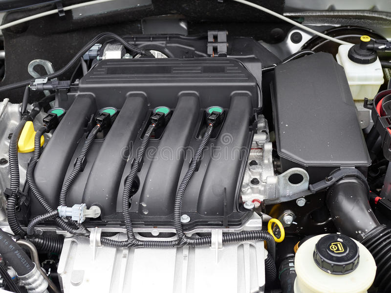 Car with open hood. Details of new car engine royalty free stock photo