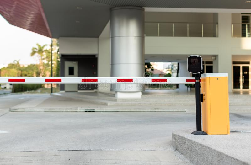 Car park automatic entry system. Security system for building access - barrier gate stop with toll booth royalty free stock photography