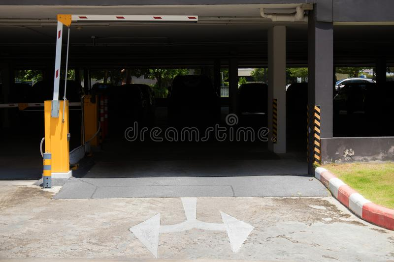car park barrier, automatic entry system.Security system for building access - barrier gate stop with toll booth, traffic cones an stock image