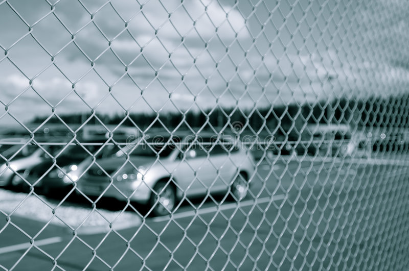 Download Car Park Behind Security Fence Stock Image - Image: 5294781