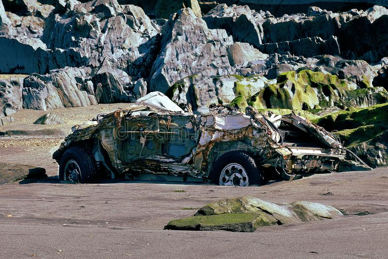 Car parked on the beach. For several days after a small accident crushed by the waves of the sea royalty free stock image