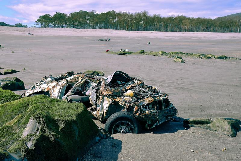 Car parked on the beach. For several days after a small accident crushed by the waves of the sea royalty free stock photos