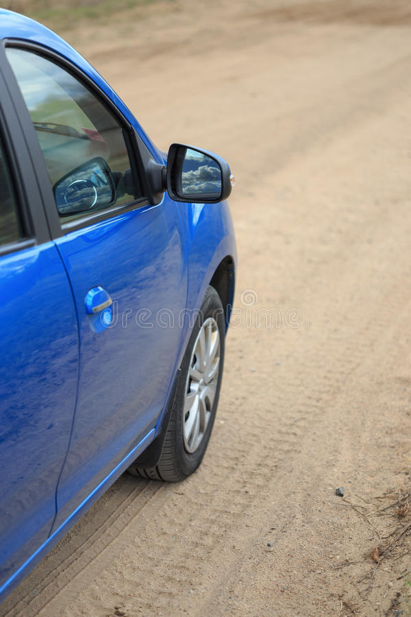 The car is parked on a country road stock images