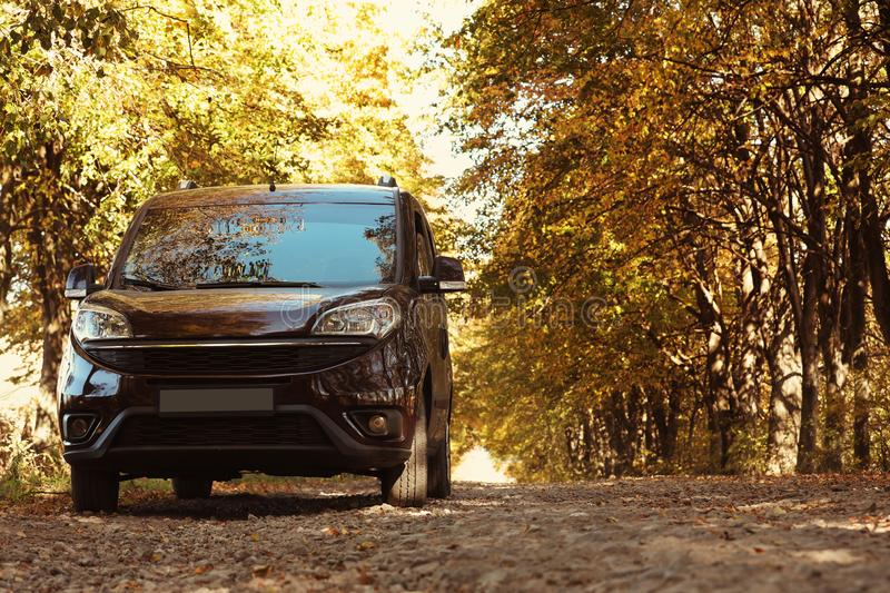 Car parked on country road near autumn fores royalty free stock images
