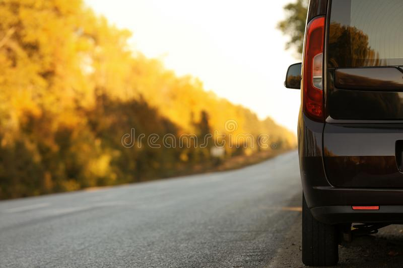 Car parked on country road. Space for text royalty free stock photos