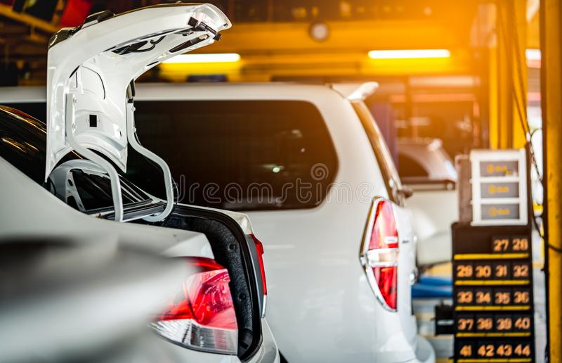 Car parked in garage wait in que for change tire and maintenance. Auto service business. Automotive parts concept. Car open trunk royalty free stock photo