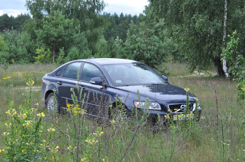 A car is parked on the grass outside the city. Luninets, Belarus - June 23, 2019: a car is parked on the grass outside the city royalty free stock photography