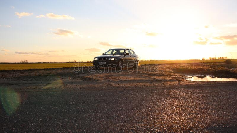 Car parked next to field royalty free stock photography