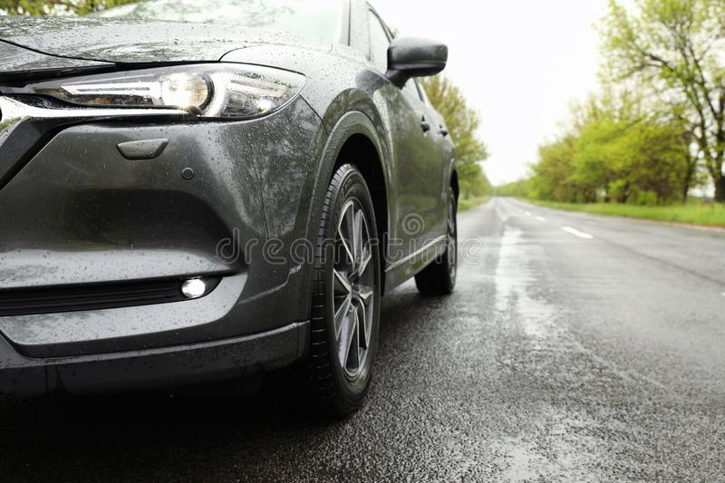 Car parked outdoors on rainy day. Closeup stock images