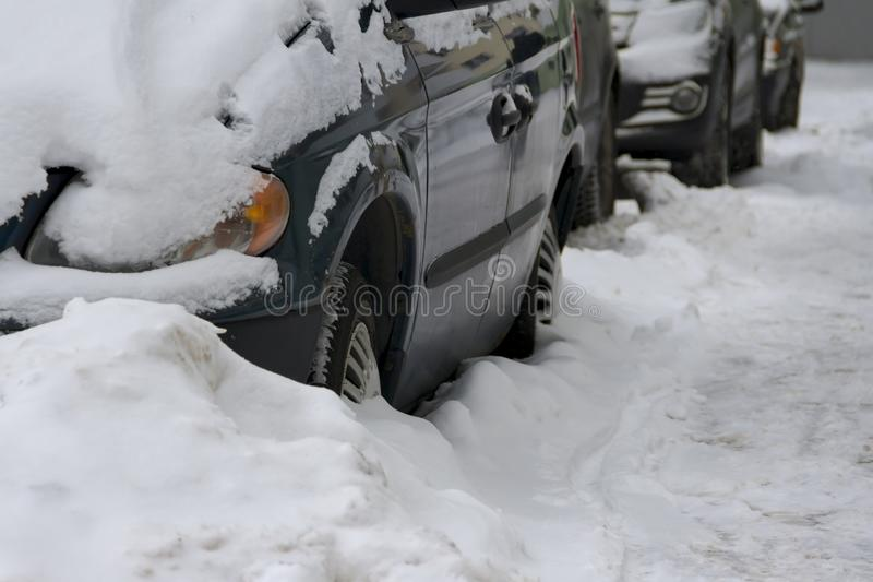 The car parked on the street which is filled up with snow royalty free stock photo