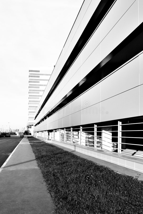 Car parking. Perspective of car parking near office building. Black and white image stock images