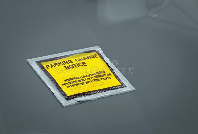Car parking charge penalty notice. Photo of a penalty charge notice fixed to a car windscreen due to illegal parking stock photography