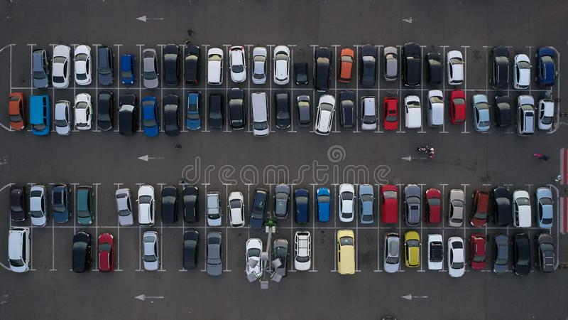 Car parking lot viewed from above, Aerial view. Top view.  stock photography