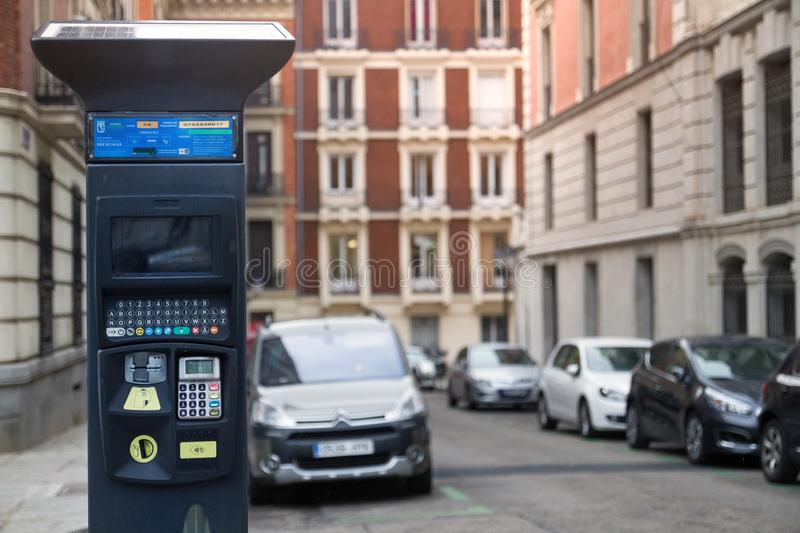 Car parking meter, machine in urban city center royalty free stock photography
