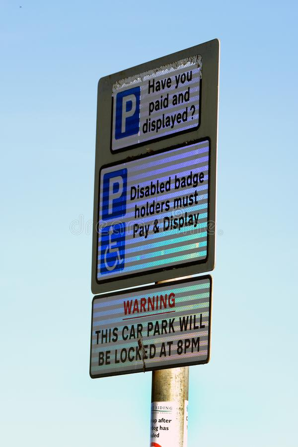 Car parking sign in day glo material. stock image