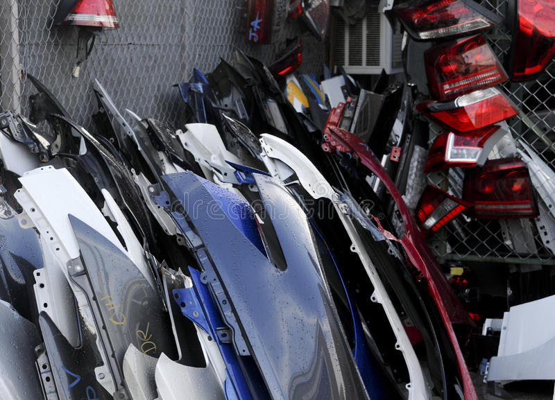 Car parts. Junk yard full of car parts like lights bumpers and doors stock image