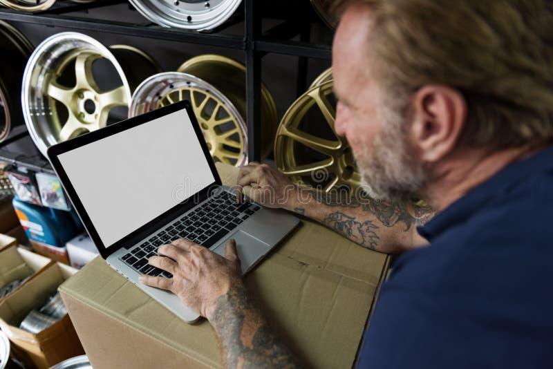 Car Parts Shop Owner Warehouse Checking Laptop Concept royalty free stock photos