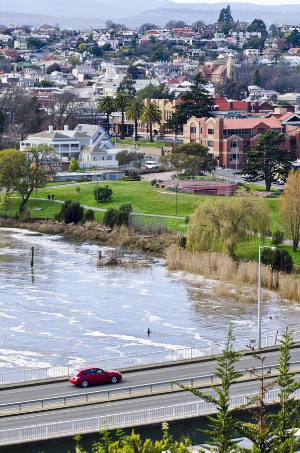 Car on Patterson Bridge, Launceston, Tasmania. Speeding car crossing Patterson Bridge with floodwater, Launceston, Tasmania, Australia royalty free stock image