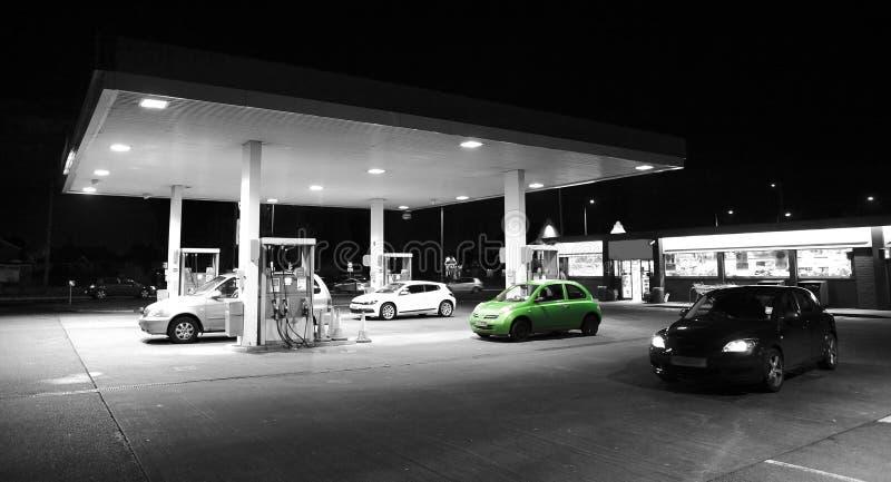 Car petrol / gas station. Go green eco concept with car at petrol / gas station forecourt stock images