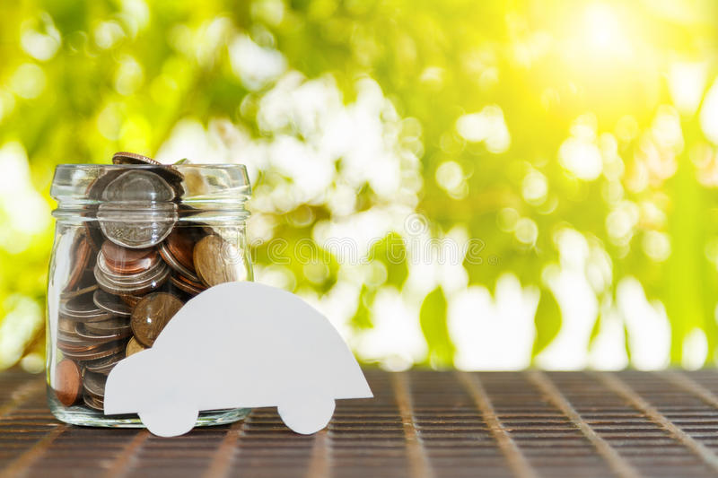 Car on a pile of money,Car with coins on background,finance concept,business background,money content and selective focus. stock photos