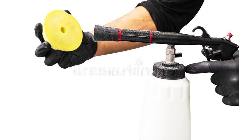 Car polish wax worker hands cleaning polishing sponge before polishing. Buffing and polishing car. Man holds a polisher sponge in. The hand cleaning it with stock images