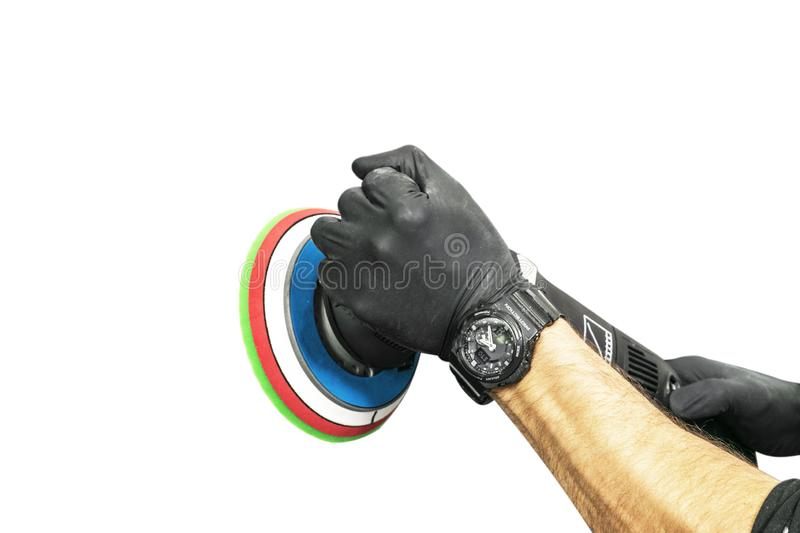 Car polish wax worker hands holing polishing tool isolated on white background. Buffing and polishing car concept. Man holds a pol. Isher in the hand and stock photos