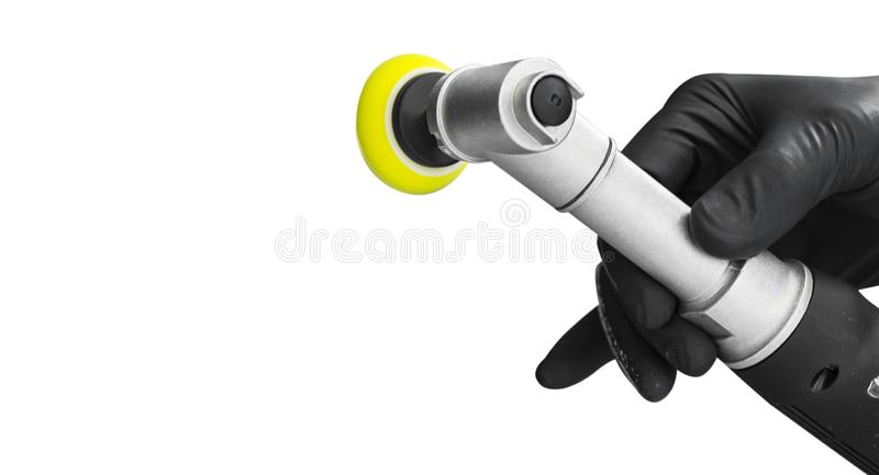 Car polish wax worker hands holing polishing tools isolated on white background. Buffing and polishing car concept. Man holds a po. Lisher in the hand and stock photography