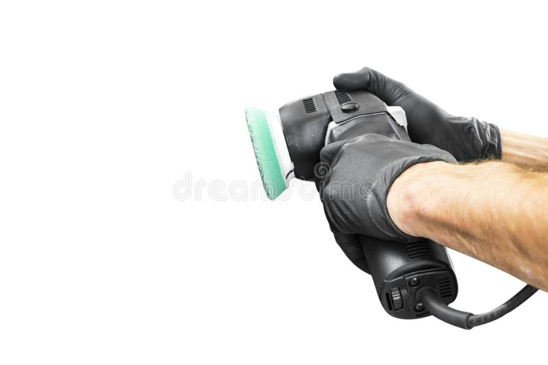 Car polish wax worker hands holing polishing tools isolated on white background. Buffing and polishing car concept. Man holds a po. Lisher in the hand and royalty free stock photo