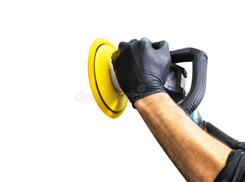 Car polish wax worker hands holing polishing tools on white background. Buffing and polishing car concept. Man holds a po. Lisher in the hand and polishes stock photo