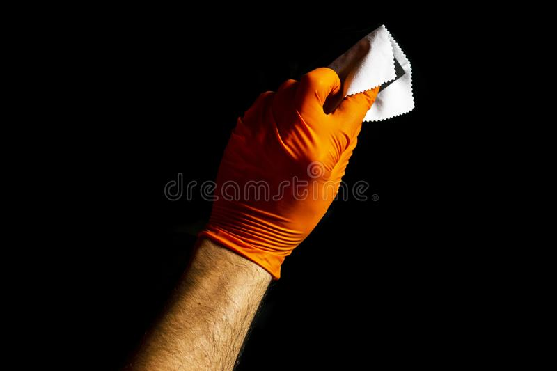 Car polish wax worker hands polishing car. Buffing and polishing vehicle with ceramic. Car detailing. Man holds a polisher in the. Hand and polishes the car royalty free stock image
