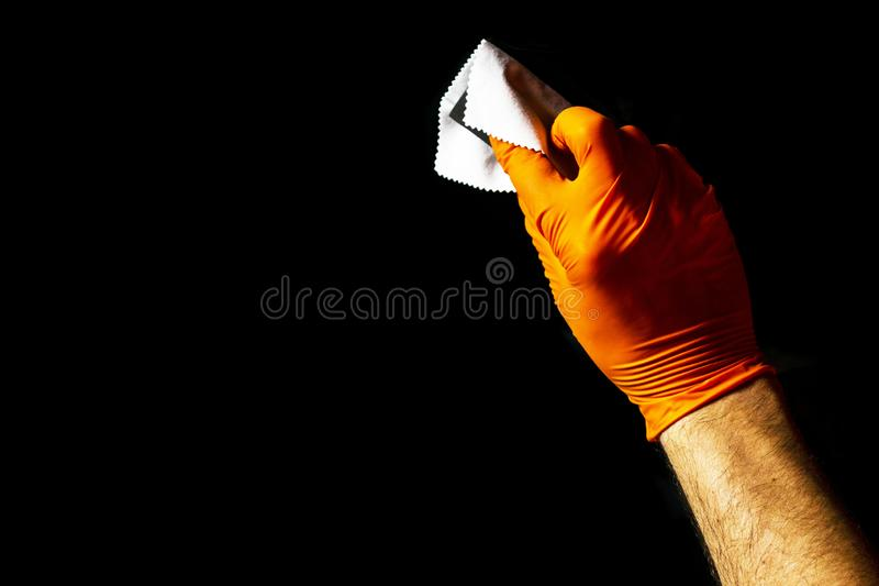 Car polish wax worker hands polishing car. Buffing and polishing vehicle with ceramic. Car detailing. Man holds a polisher in the royalty free stock image