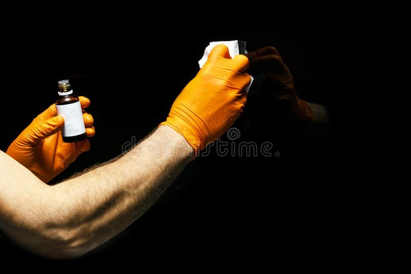 Car polish wax worker hands polishing car. Buffing and polishing vehicle with ceramic. Car detailing. Man holds a polisher in the. Hand and polishes the car stock image