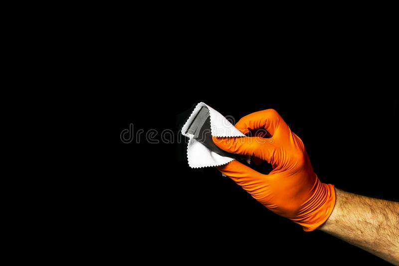 Car polish wax worker hands polishing car. Buffing and polishing vehicle with ceramic. Car detailing. Man holds a polisher in the royalty free stock photos