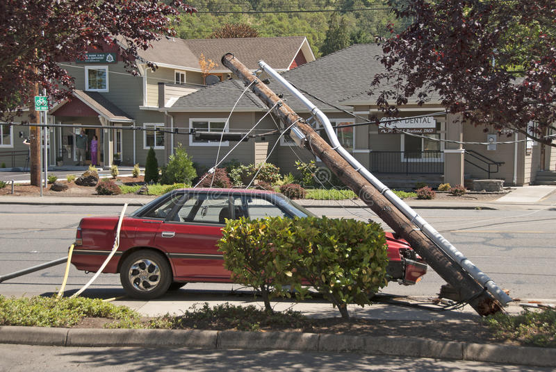 Car and Power Pole. Roseburg, Oregon, July 15, 2010: Single motor vehicle accident that hit a power pole causing a area wide power outage and closed down Harvard stock photos