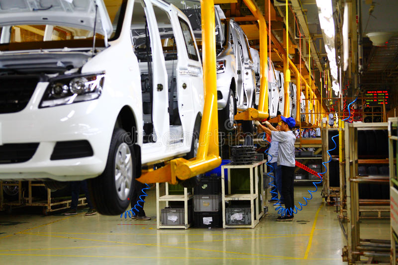 Car production line. The car production line is in a factory