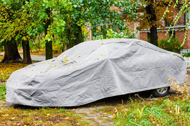 Car with protective cover. Car with automotive awning for protection from sun,atmospheric phenomena or rainfall stock image