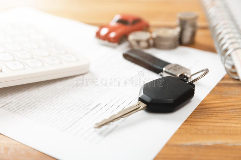 Car purchase concept. Car keys, calculator, toy car, coins and purchase contract. In a natural light stock images