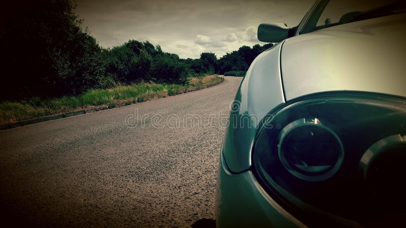 Car on a quiet country road stock photography