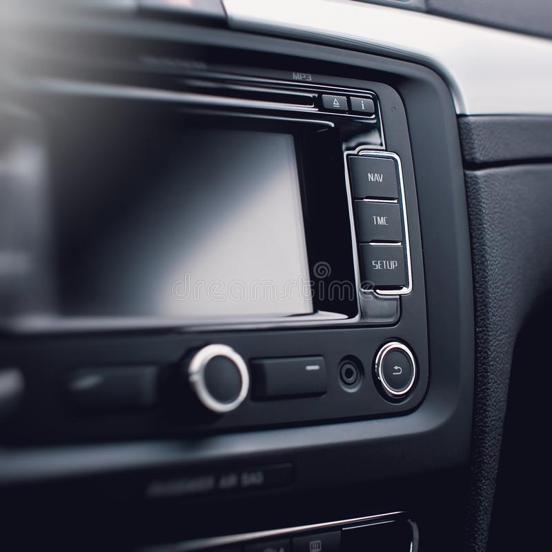 Modern car audio system, control buttons. stock photo