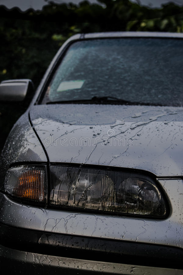 Car in the rain royalty free stock photos