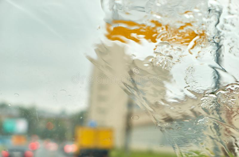 Car rain window as wet background with  water droplets stock photo