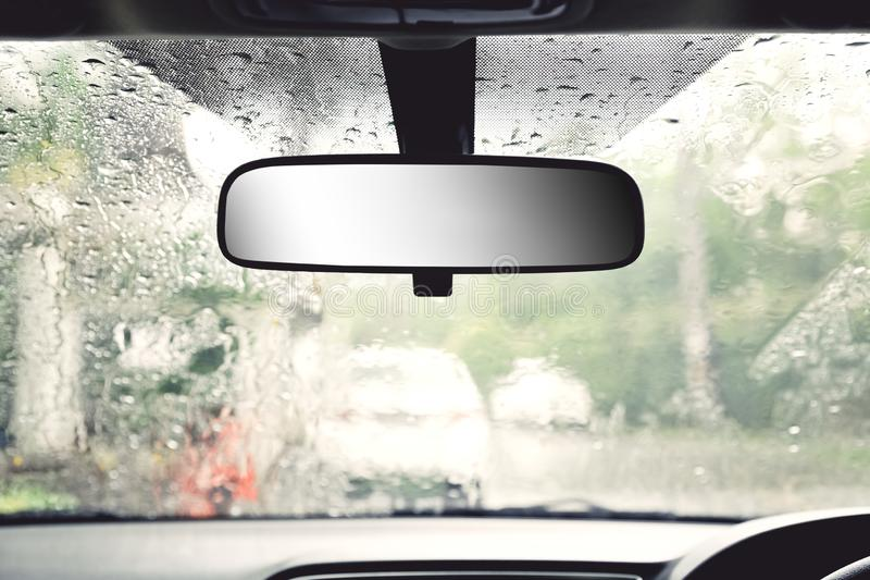 Car rare view mirror. Closeup car rear view mirror with raining outside royalty free stock images