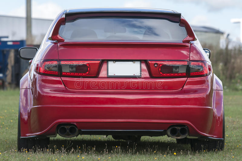 Car rear end. Picture of red honda civic import car rear and with blank licence plate royalty free stock images