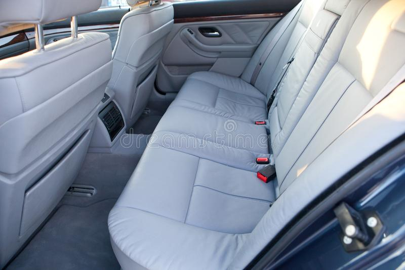 Car rear seats. Grey color modern car interior. Back seats. Side view royalty free stock photography
