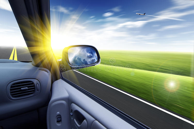 Car and rear view mirror. Car,road,cloud and rear view mirror royalty free stock images