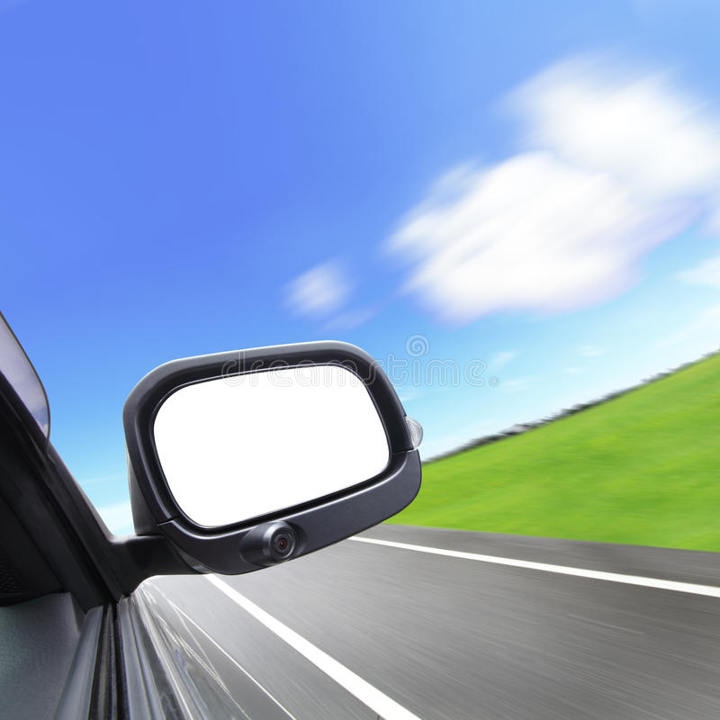Car and rear view mirror. On the road royalty free stock image