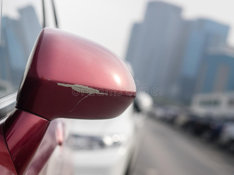Car rear view mirror. Scratch on car rear view mirror royalty free stock photography