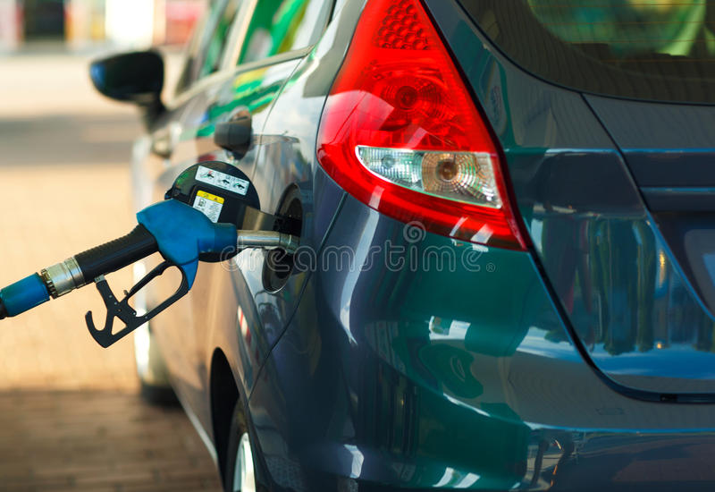 Car refueling on a petrol station close up stock photography