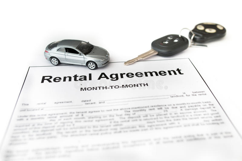 Car rental agreement with car on center. Auto rental agreement or legal document royalty free stock photo