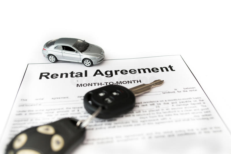 Car rental agreement with car on center. Auto rental agreement or legal document royalty free stock photos